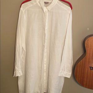 Long white crisp linen blouse.